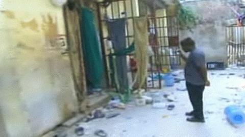 Cửa các phòng giam tại nhà tù ở thủ đô Haiti mở toang (Ảnh: CNN)